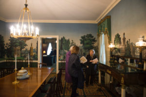 Gracie Mansion visitors moving through the dining room.