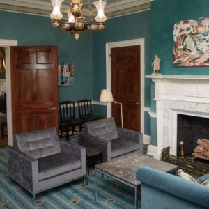 Gray Knoll chairs are seamlessly integrated into the decore of the the sea green hues of the Library at Gracie Mansion.